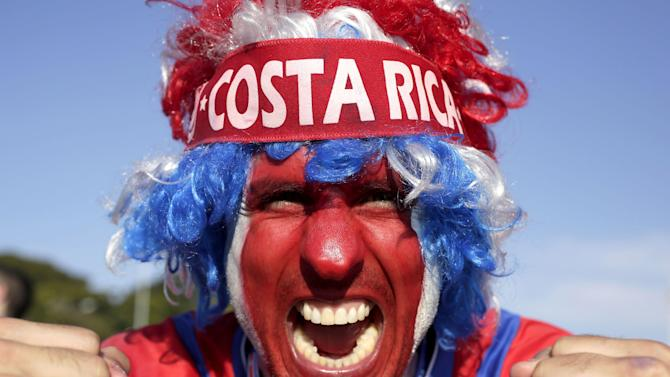 In this June 24, 2014 photo, a supporter celebrates Costa Rica's classification at the end of the World Cup group D match against England, at the Mineirao Stadium, in Belo Horizonte, Brazil, Tuesday. Costa Rica finished first in what many considered the World Cup's toughest group after a dour 0-0 draw against England. The Central Americans face Greece in the knockout stage, in Recife, Sunday, June 29. (AP Photo/Bruno Magalhaes)