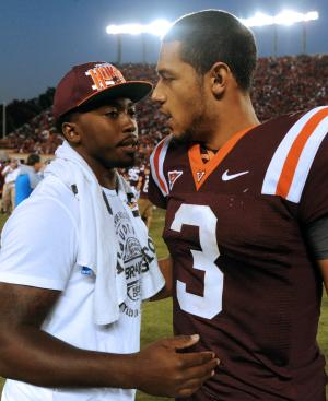 Virginia Tech quarterback Logan Thomas (3) is congratulated by former Virginia Tech quarterback Tyrod Taylor after defeating Miami 38-35 in an NCAA college football game Saturday, Oct. 8, 2011, in Blacksburg, Va. (AP Photo/Don Petersen)