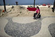 Brazilian Viviane Macedo, 35, rides her wheelchair at Copacabana beach in Rio de Janeiro. Only half of the city's bus fleet is adapted to carry the handicapped, compared with 100 percent in London, which has just staged very successful Paralympics