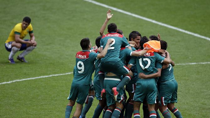 Aug. 11 Mexico players celebrate winning the gold medal during the men's soccer final against Brazil at the 2012 Summer Olympics, Saturday, Aug. 11, 2012, in London. (AP Photo/Andrew Medichini)