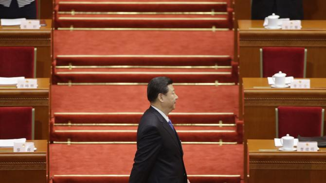 File photo of China's Communist Party Chief Xi arriving before the opening ceremony of the National People's Congress