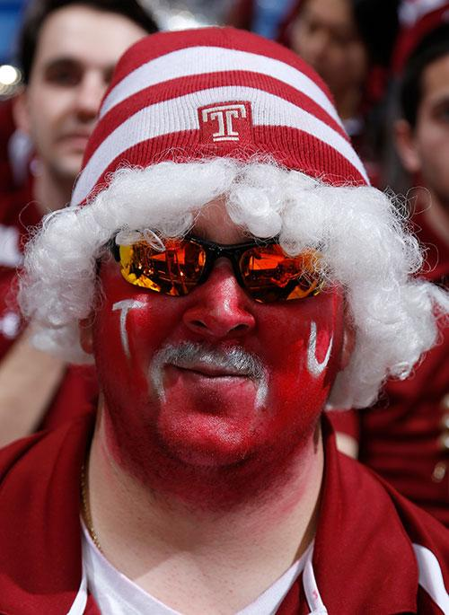 A Temple fan looks on during the NCAA tournament. (Getty)