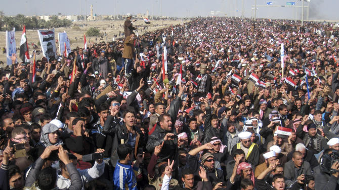 """Protesters chant slogans against the Iraq's Shiite-led government as they wave national flags during a demonstration in Fallujah, 40 miles (65 kilometers) west of Baghdad, Iraq, Friday, Jan. 4, 2013. About 3,000 people gathered in the northern city of Mosul, where they called for the release of female prisoners and to end to what they say are random arrests of Sunnis. Among their chants were: """"Down, down with al-Maliki"""" and """"No to sectarianism."""" In the ethnically mixed city of Kirkuk, about 1,000 protested to demand the release of Sunni detainees. Protests were also reported in the Sunni strongholds of Fallujah and Tikrit. (AP Photo)"""