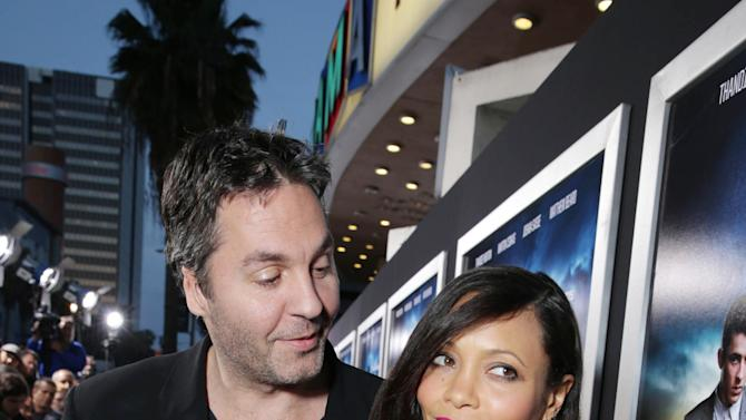 Ol Parker and Wife Thandie Newton at the Los Angeles Premiere of DirecTV original series ROGUE, on Tuesday, March, 26, 2013 in Los Angeles held at Arclight Hollywood. (Photo by Eric Charbonneau/Invision for Sunshine Sachs/AP Images)