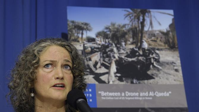 Letta Tayler, senior counterterrorism researcher at Human Rights Watch talks about the findings of two new reports, by Amnesty International and Human Rights Watch on US drone strikes and other air strikes in Pakistan and Yemen, Tuesday, Oct. 22, 2013, during a news conference at the National Press Club in Washington. (AP Photo/Susan Walsh)