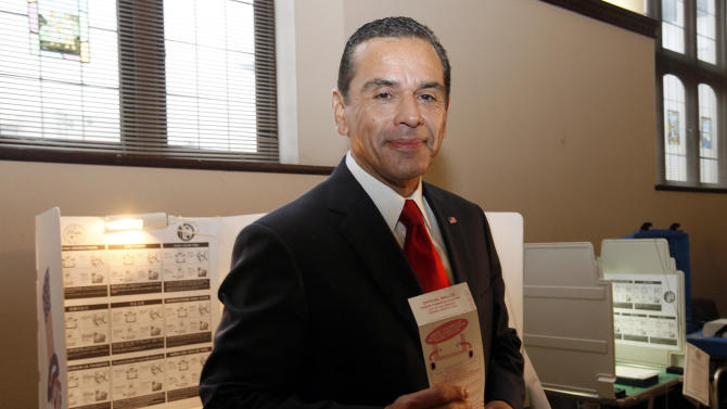 Los Angeles Mayor Antonio Villaraigosa smiles at media after voting Tuesday March 5, 2013 in Los Angeles.  Los Angeles voters are going to the polls to choose a new mayor. Polls show a tight contest between Councilman Eric Garcetti and City Controller Wendy Greuel in the race to replace term-limited Mayor Antonio Villaraigosa. An expected low turnout makes surprises more likely, boosting the chances of Democratic Councilwoman Jan Perry and Republican Kevin James, a former prosecutor and radio talk show host. If no one gets more than 50 percent of the vote, then the top two candidates will face each other in a May runoff.   (AP Photo/Nick Ut )
