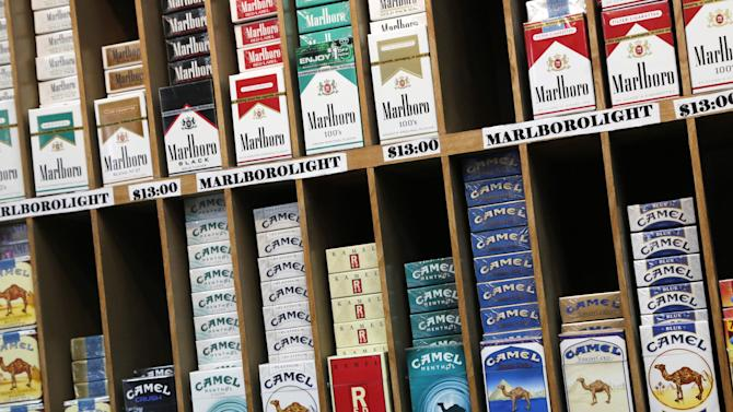 In this March 18, 2013 file photo cigarette packs are displayed for sale at a convenience store in New York. No one under 21 would be able to buy cigarettes in New York City under a proposal unveiled Monday, April 22, 2013 to make the city the most populous place in America to set the minimum age that high. (AP Photo/Mark Lennihan, file)