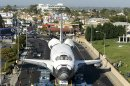 Spectators take in the view of the space shuttle Endeavour as it stops in front of the Forum in Los Angeles