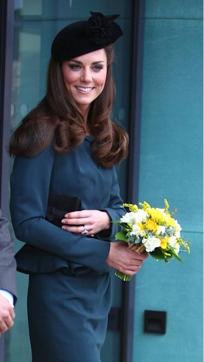 Here's Kate on the first day of the Diamond Jubilee tour on March 8 in Leicester, England. She wears dark green tailored peplum jacket and matching jacket from British high street brand LK Bennett. Sh