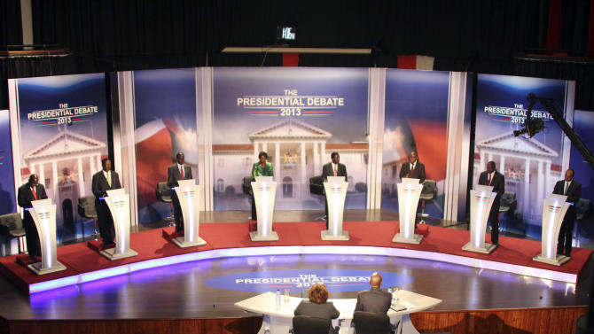 Kenyan presidential candidates, from left, James Ole Kiyiapi,  Musalia Mudavadi, Paul Muite, Martha Karua, Raila Odinga, Mohammed Abdula Dida, Uhuru Kenyatta and Peter Kenneth, take part in the second televised debate in Nairobi, Kenya,  Monday, Feb. 25, 2013. Kenya holds another high-tension election next Monday, and though officials are working to prevent a repeat of violence, there are signs it may again return. (AP Photo/Nation,  Joan Pereruan)