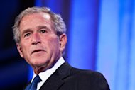 Former US president George W. Bush speaks at a summit in Washington in September 2011. Bush received a warm welcome in Tanzania Thursday on the first stop on an African philanthropic tour, despite a rights group's call for the former US president's arrest on torture charges. (AFP Photo/Brendan Hoffman)