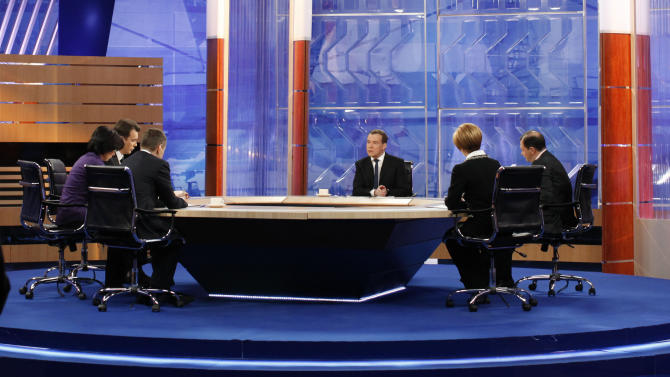 Russian Prime Minister Dmitry Medvedev, center, speaks during live televised interview from Moscow's Ostankino TV Center on Friday, Dec. 7, 2012.  Medvedev answers questions from TV hosts of Russia Federal TV Channels.(AP Photo/RIA Novosti, Dmitry Astakhov, Government Press Service)
