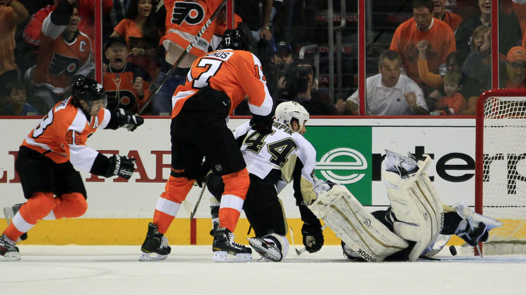Philadelphia Flyers Danny Briere, far left, watches his wrist shot get past  Pittsburgh Penguins goalie Marc-Andre Fleury for a gaol during the first period of Game 3 in a first-round NHL Stanley Cup playoffs hockey series, Sunday, April 15, 2012, in Philadelphia. (AP Photo/Tom Mihalek)