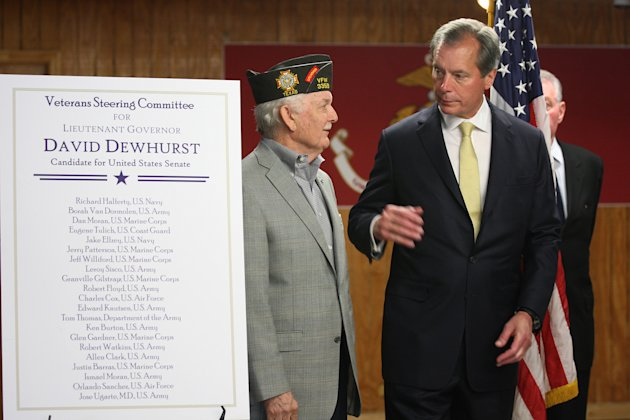 Texas Lt. Gov. David Dewhurst talks with former Veterans of Foreign Wars Commander-in-Chief Glen Gardner, during a campaign stop at the VFW Post 76, in San Antonio, Monday, July 30, 2012. Dewhurst was