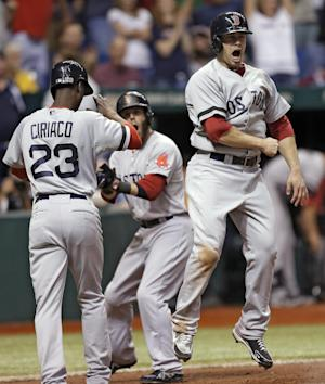 Boston Red Sox's Daniel Nava, right, celebrates with teammates Pedro Ciriaco, left, and Dustin Pedroia, center, after scoring on a three-run, ninth-inning double by Will Middlebrooks off Tampa Bay Rays relief pitcher Fernando Rodney during a baseball game Thursday, May 16, 2013, in St. Petersburg, Fla. (AP Photo/Chris O'Meara)