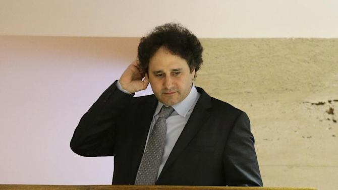 Sacramento Kings part owner George Maloof talks to a reporter from an overhead floor at a hotel during the NBA Board of Governors meeting Wednesday, May 15, 2013, in Dallas. The meeting is an effort to resolve the five-month-long struggle over the future of the Kings. The board's tasks: Decide whether the team should move to Seattle or stay in Sacramento, and then figure out who should own the troubled franchise. (AP Photo/Tony Gutierrez)