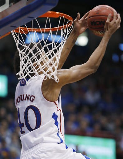 Young helps No. 6 Kansas turn back Temple, 69-62