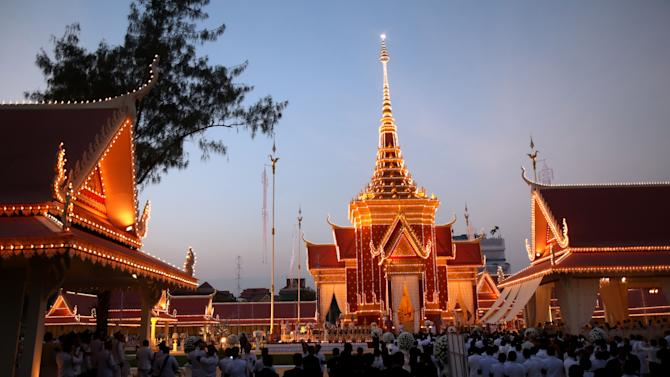 "The crematorium site for Cambodia's former King Norodom Sihanouk is seen at dusk in Phnom Penh Monday, Feb. 4, 2013. Hundreds of thousands of mourners gathered in Cambodia's capital Monday for the cremation of Sihanouk, the revered ""King-Father,"" who survived wars and the murderous Khmer Rouge regime to hold center stage in the Southeast Asian nation for more than half a century. (AP Photo/Wong Maye-E)"