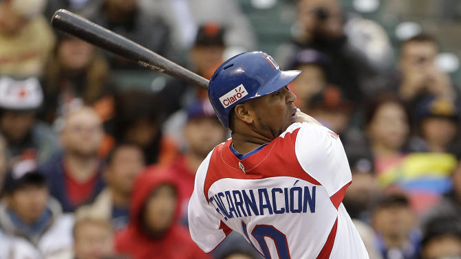 The Dominican Republic's Edwin Encarnacion (10) hits a two-run double off of Puerto Rico's Giancarlo Alvarado during the first inning of the championship game of the World Baseball Classic in San Francisco, Tuesday, March 19, 2013. (AP Photo/Eric Risberg)