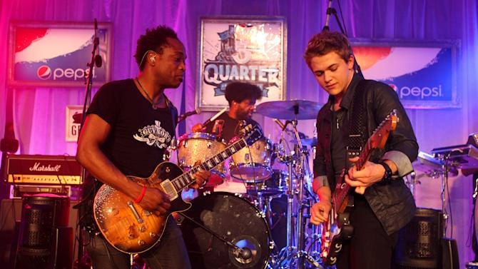 IMAGE DISTRIBUTED FOR PEPSI - Captain Kirk Douglas and ?uestlove of The Roots with Hunter Hayes perform at the Pepsi 5th Quarter in the French Quarter Post Super Bowl Party, on Sunday, Feb. 3, 2013, in New Orleans. (Photo by Barry Brecheisen/Invision for Pepsi/AP Images)