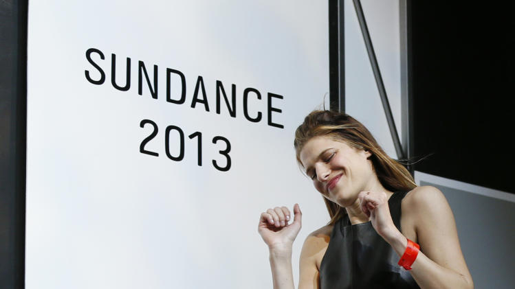 "Director, writer and cast member Lake Bell celebrates as she comes on stage to accept her U.S. Dramatic Waldo Salt Screenwriting Award for ""In A World..."" during the 2013 Sundance Film Festival Awards Ceremony on Saturday, Jan. 26, 2013 in Park City, Utah. (Photo by Danny Moloshok/Invision/AP)"