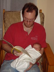 Reading to my son on his first night at home.