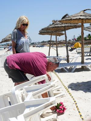 A couple of tourists lay flowers at the scene of Friday's…