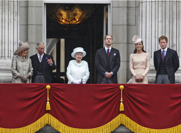 Britain's Queen Elizabeth II, center, accompanied by Prince Charles and the Duchess if Cornwall, left,  Prince William, and Kate, Duchess of Cambridge and Prince Harry, appear on the balcony of Buckin