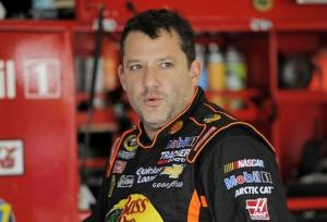 File photo of NASCAR Sprint Cup Series driver Tony Stewart speaking with crew members during practice for the Daytona 500 qualifying at Daytona International Speedway