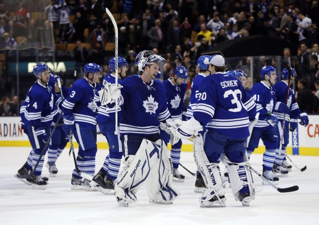 Toronto Maple Leafs goalie Reimer celebrates with teammates after they defeated the Ottawa Senators during their NHL hockey game in Toronto