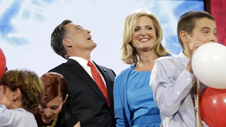 Republican presidential nominee Mitt Romney looks up to the balloons as his wife Ann and family take stage after his speech at the Republican National Convention in Tampa, Fla., on Thursday, Aug. 30, 2012. (AP Photo/Charles Dharapak)