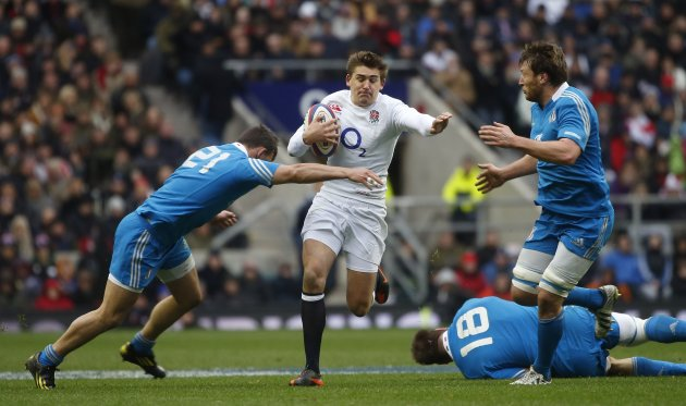 England's Toby Flood is tackled by Italy's Antonio Pavanello and Simone Favaro during their Six Nations international rugby union match at the Twickenham Stadium in London