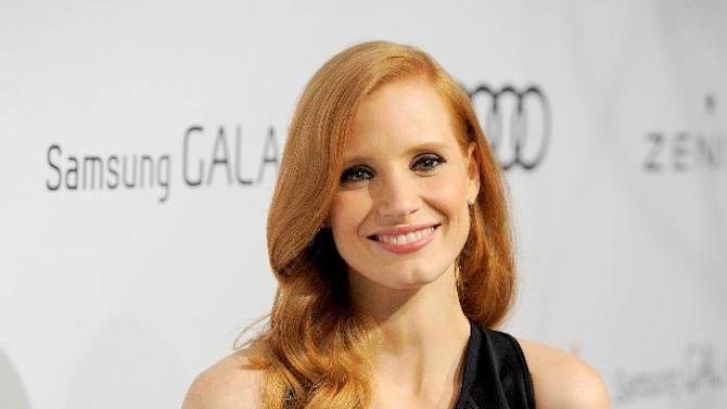 IMAGE DISTRIBUTED FOR THE HOLLYWOOD REPORTER - Jessica Chastain arrives at The Hollywood Reporter Nominees' Night at Spago on Monday, Feb. 4, 2013, in Beverly Hills, Calif. (Photo by Chris Pizzello/Invision for The Hollywood Reporter/AP Images)