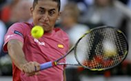 Spain's Nicolas Almagro returns a ball to USA's John Isner during the second match of the Davis Cup semi-final at the Hermanos Castro park court in Gijon, northern Spain. Almagro won 6-4, 4-6, 6-4, 3-6, 7-5