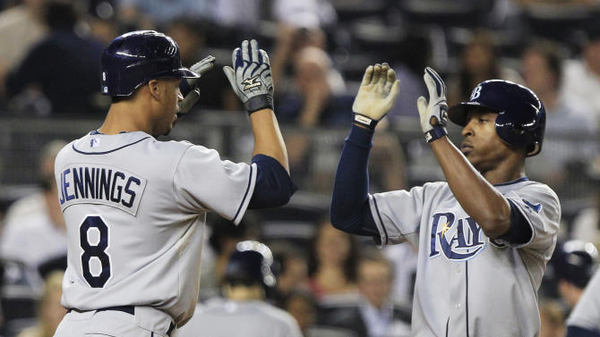 Tampa Bay Rays' B.J. Upton, right, celebrates with Desmond Jennings, left, after Upton's two-run home run during the fourth inning of a baseball game against the New York Yankees on Thursday, Sept. 22, 2011, at Yankee Stadium in New York. (AP Photo/Frank Franklin II)