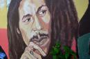 "FILE - In this Feb. 6, 2013 file photo, a mural depicting reggae music icon Bob Marley decorates a wall in the yard of Marley's Kingston home in Jamaica. A U.S. private equity firm announced Tuesday, Nov. 18, 2014 it has joined the family of late reggae star Bob Marley in hopes of building what it touts as the ""world's first global cannabis brand."" (AP Photo/ David McFadden, File)"