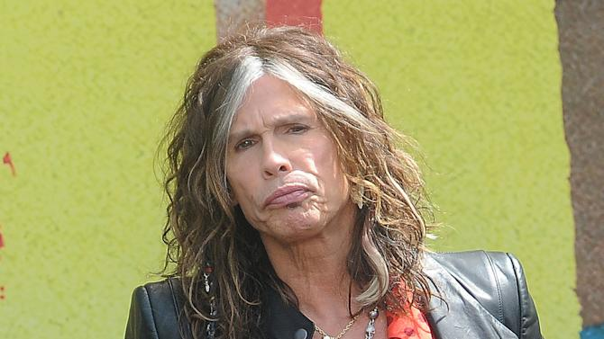 """FILE - This March 28, 2012 file photo shows Steven Tyler speaking at the Aerosmith news conference announcing the 2012 Global Warming Tour  in Los Angeles. Tyler announced Thursday, July 12, 2012 that he will not be returning as a judge on the singing competition series """"American Idol."""" Tyler served as a judge with singer/actress Jennifer Lopez and Randy Jackson on the 10th and 11th season of the series. (AP Photo/Katy Winn, file)"""