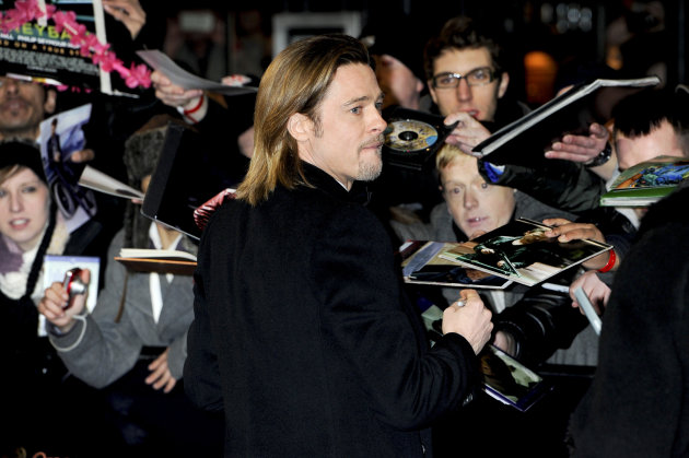 Actor Brad Pitt arrives for the BAFTA Film Awards 2012, at The Royal Opera House in London, Sunday, Feb. 12, 2012. (AP Photo/Jonathan Short)