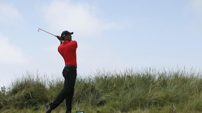 Tiger Woods of the US plays a shot off the 13th tee during the final round of the British Open Golf championship at the Royal Liverpool golf club, Hoylake, England, Sunday July 20, 2014. (AP Photo/Jon Super)