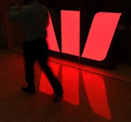 The Westpac Bank logo. A New Zealand man who fled to China after a bank mistakenly deposited millions of dollars into his account was jailed for four years and seven months Friday