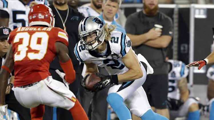 In this Aug. 17, 2014, file photo, Carolina Panthers' Brenton Bersin (2) runs after a catch as Kansas City Chiefs' Husain Abdullah (39) defends during the first half of a preseason NFL football game in Charlotte, N.C., Sunday, Aug. 17, 2014. Bersin is the first Wofford player to make an NFL roster since the man who employs him _ Panthers team owner Jerry Richardson