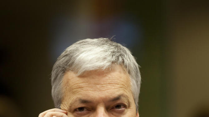 Belgium's Foreign Minister Didier Reynders speaks on his cellphone during a meeting of EU foreign ministers at the EU Council building in Brussels on Monday, Dec. 10, 2012. The 27 EU foreign ministers will discuss the situation in Syria, where activists say more than 40,000 people have died. (AP Photo/Virginia Mayo)