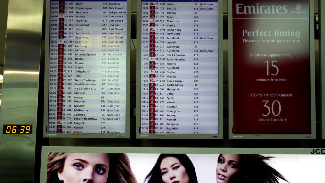 In this Sunday, Feb. 10, 2013, photo, an aircraft departure board shows Emirates airlines' schedule at the new Concourse A of Dubai airport in Dubai, United Arab Emirates. For generations, international fliers have stopped over in London, Paris and Amsterdam. Now, they increasingly switch planes in Dubai, Doha and Abu Dhabi, making this region the new crossroads of global travel. The switch is driven by both the airports and airlines, all backed by governments that see aviation as the way to make their countries bigger players in the global economy. (AP Photo/Kamran Jebreili)