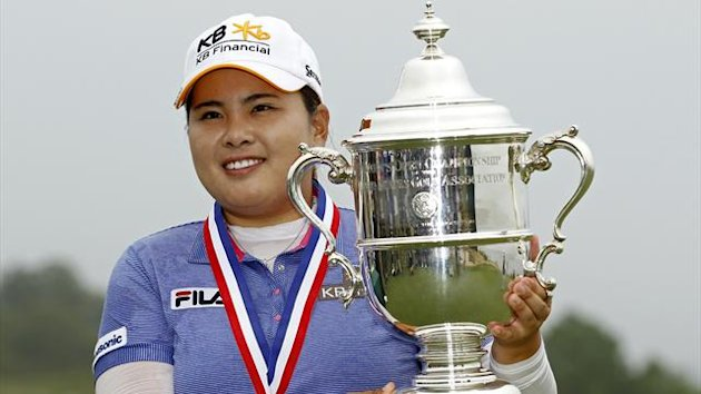 Inbee Park of South Korea holds the 2013 Harton S. Semple Trophy after winning the 2013 U.S. Women's Open (Reuters)