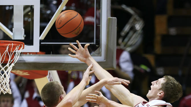 Indiana's Cody Zeller, right, shoots against Wisconsin's Jared Berggren during the first half of an NCAA college basketball game, Tuesday, Jan. 15, 2013, in Bloomington, Ind. (AP Photo/Darron Cummings)
