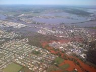 Floodwaters surround properties in Bundaberg in Australia&#39;s Queensland state on January 29, 2013, in this photo taken by Queensland Premier Campbell Newman. In worst-hit Bundaberg, which was devastated as the Burnett River peaked at a record 9.6 metres (32 feet), authorities moved into recovery mode after the floods inundated about 2,000 homes and 200 businesses