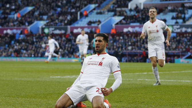 Emre Can celebrates scoring the third goal for Liverpool