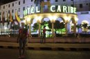 Prostitutes walk in front of the Hotel Caribe in Cartagena