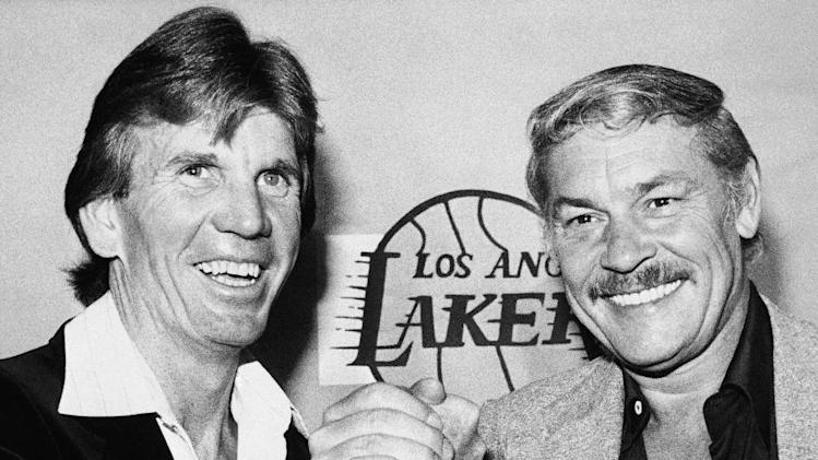 FILE - In this April, 1980 file photo, Los Angeles Lakers coach Paul Westhead, left, shake hands with Lakers' owner Jerry Buss in Los Angeles. Buss, the Lakers' playboy owner who shepherded the NBA franchise to 10 championships, has died. He was 79. Bob Steiner, an assistant to Buss, confirmed Monday, Feb. 18, 2013  that Buss had died in Los Angeles. Further details were not available. (AP Photo/File)