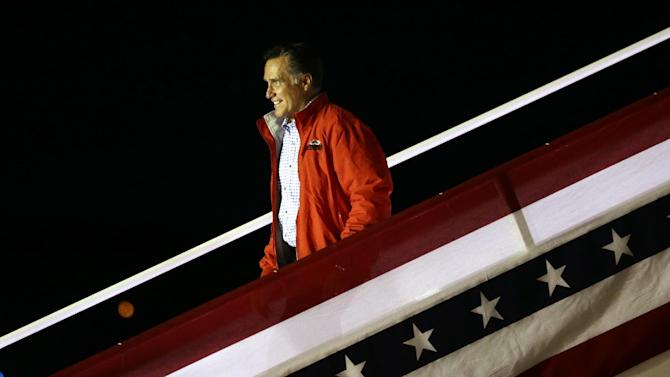 Republican presidential candidate and former Massachusetts Gov. Mitt Romney steps off his campaign plane in Weyers Cave, Va., Sunday, Oct. 7, 2012. (AP Photo/Charles Dharapak)